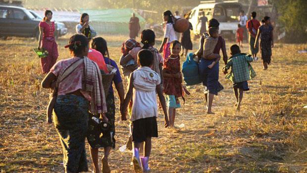 People displaced by violence between ethnic Rakhine rebels and Myanmar's army arrive at a camp in Kyauktaw, Rakhine state, Jan. 4, 2019.