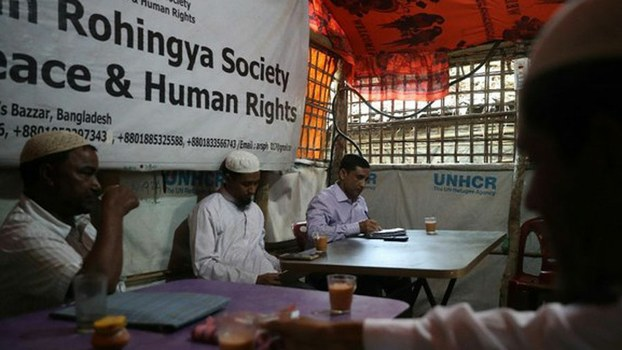 Mohib Ullah, a leader of the Arakan Rohingya Society for Peace and Human Rights (right), works in his office in the Kutupalong camp in Cox's Bazar, Bangladesh, April 7, 2019.