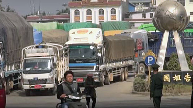 Trucks line up at a border crossing between southwest China's Yunnan province and Myanmar's northern Shan state, April 10, 2020.