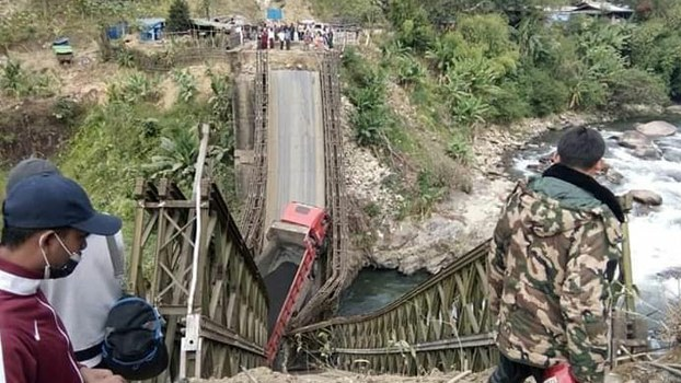 The scene after trucks carrying ore bound for China plunged into the Irawaddy River on the highway connecting Myitkyina, the capital of Myanmar's Kachin State, and the Chinese border, Dec. 14, 2018.