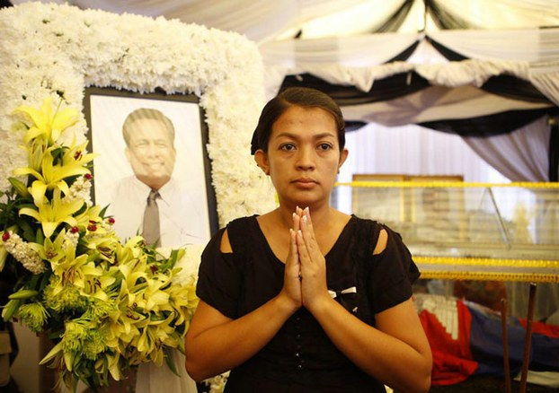 Bou Rachana stands in front of an image of slain husband Kem Ley.