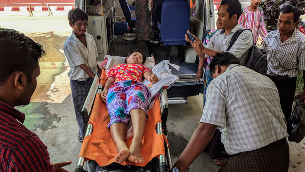 A child injured by mortar shell explosions in western Myanmar's war-ravaged Rakhine state arrives at a hospital in Sittwe, Oct. 3, 2019.