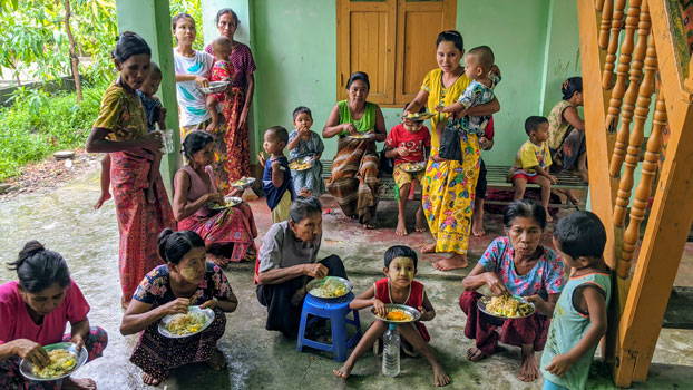 Myanmar woman and children who fled armed conflict in Rathedaung township, northern Rakhine state, find temporary shelter in Rakhine's capital Sittwwe, July 1, 2020.