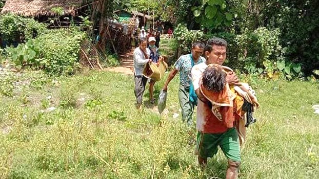 Villagers carry children injured and killed by explosions from artillery shells out of Nyaung Khet Kan village on the border between Ann and Myebon townships in western Myanmar's Rakhine state, Sept. 8, 2020.