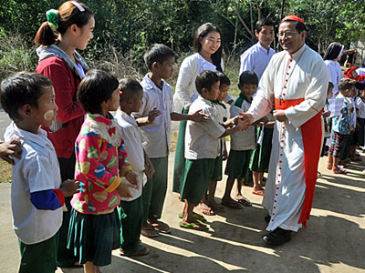 Myanmar Cardinal Charles Maung Bo greets Catholic parishoners outside a church in Tanphaye village, northern Myanmar's Kachin state, Dec. 14, 2017.