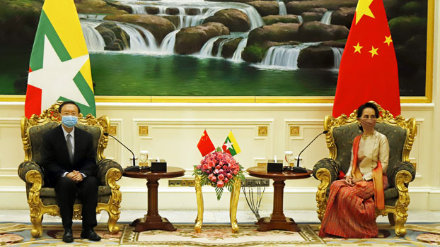 Myanmar's State Counselor Aung San Suu Kyi (R) meets with Yang Jiechi (L), director of the Office of Foreign Affairs of the Communist Party of China, at the Presidential Palace in Naypyidaw, Sept. 1, 2020.