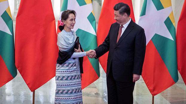 Myanmar State Counselor Aung San Suu Kyi (L) shakes hands with Chinese President Xi Jinping (R) at the Great Hall of the People in Beijing, April 24, 2019.