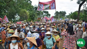 Thousands of residents march in protest against Myanmar military troops who opened fire in a civilian village, killing one resident and injuring another amid a clash with a local ethnic army, near Kyaukme town, northeastern Myanmar's Shan state, July 10, 2020.