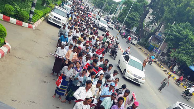 Myanmar citizens protest against the regional government after it did not object to a Chinese-backed company's request to conduct a ground inspection for a new copper mine project, in Monywa, northwestern Myanmar's Sagaing region, Sept. 30, 2019.
