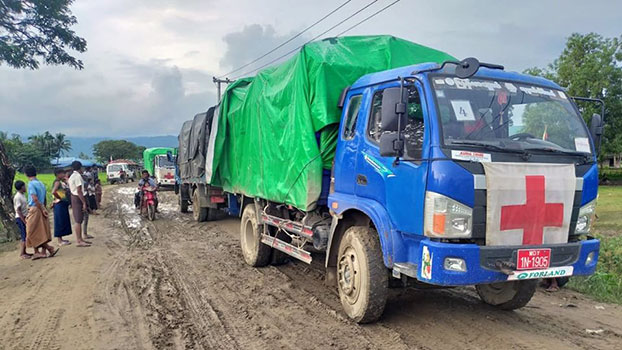 International Committee of the Red Cross trucks arrive with food and seeds for displaced civilians in Buthidaung township, western Myanmar's Rakhine state, October 2019.