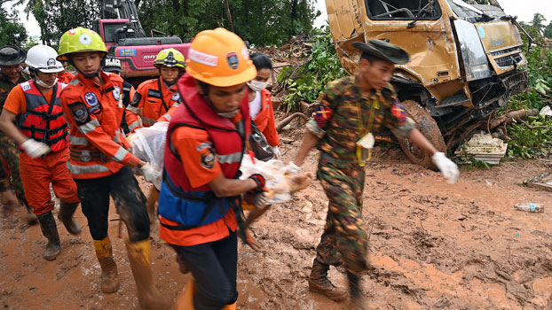 Rescue workers carry the body of a landslide victim in Paung township, southeastern Myanmar's Mon state, Aug. 10, 2019.
