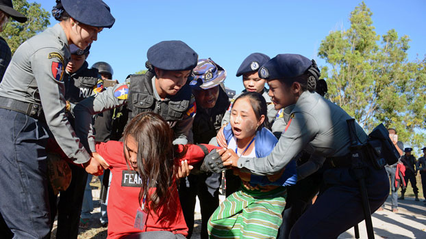 Police officers arrest activists during a protest against a statue of General Aung San, Myanmar's independence hero and the father of leader Aung San Suu Kyi, in Loikaw, capital of eastern Myanmar's Kayah state, Feb. 7, 2019.