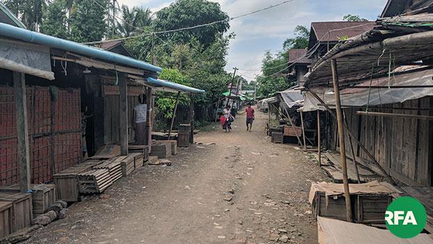 Young people walk along a dirt road in Panmyaung village, Minbya township, western Myanmar's Rakhine state, Nov. 18, 2019.