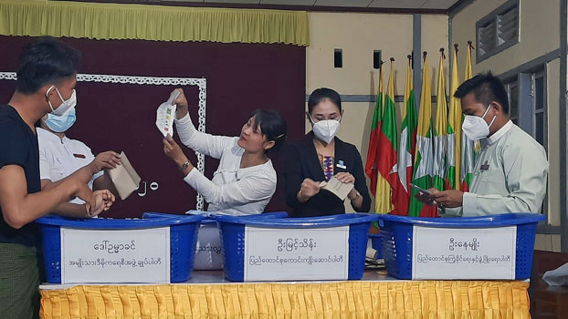 Myanmar election officials count ballots cast by voters at a polling station in Launglon township, southern Myanmar's Thanintharyi region, following nationwide elections, Nov. 8, 2020.