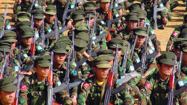 Ta'ang National Liberation Army soldiers march during a military parade commemorating the ethnic army's Revolution Day in Kyaukme township, Myanmar's northern Shan state, Jan. 14, 2016.