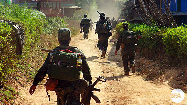 Soldiers from the Restoration Council of Shan State/Shan State Army pass though a village in eastern Myanmar's Shan state in an undated photo.