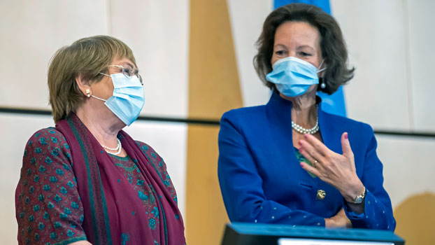 Michelle Bachelet (L), the UN high commissioner for human rights, speaks with Elisabeth Tichy-Fisslberger (R), president of the Human Rights Council, during the opening of the 45th council session at the UN's European headquarters in Geneva, Sept. 14, 2020.