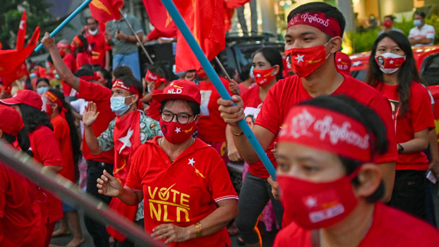 Myanmar supporters of the National League for Democracy party celebrate outside the party's headquarters in Yangon, Nov. 9, 2020, after NLD officials said they were confident of a landslide victory in Sunday's elections.