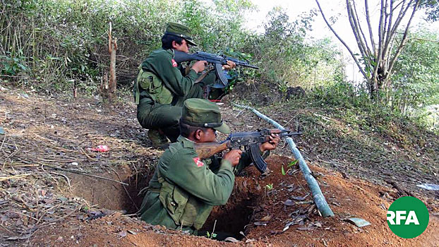 Shan State Army-North soldiers aim their weapons while on patrol in Myanmar's northern Shan State in an undated photo.