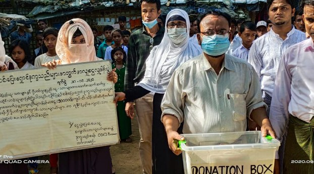 Rohingya refugees in Cox's Bazar, Bangladesh, are shown raising funds for ethnic Rakhine displaced by fighting in Myanmar, Sept. 28, 2020.