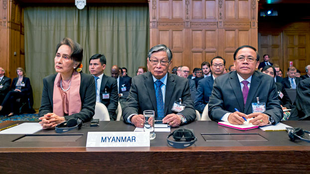 Myanmar's State Counselor Aung San Suu Kyi (L) and members of the Myanmar delegation attend the start of a three-day hearing on the Rohingya genocide case before the International Court of Justice in The Hague, the Netherlands, Dec. 10, 2019.