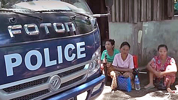 Women wait outside a police station for their detained relatives to be released in western Myanmar's Rakhine state in a file photo.