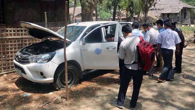Members of a Myanmar government investigative committee inspect an UN-marked vehicle that was attacked by gunmen, in Minbya township, western Myanmar's Rakhine state, May 13, 2020.