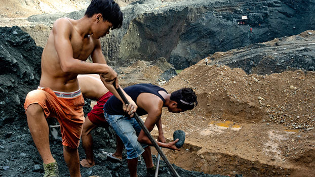 Prospectors dig for jade remnants on a slag heap at a mine near Ma Mon village in Hpakant township, northern Myanmar's Kachin state, July 9, 2020.