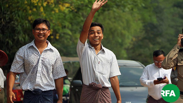 Reuters Myanmar reporters Wa Lone (L) and Kyaw Soe Oo (R) gesture as they walk toward the gate of Insein Prison in Yangon after being released under a presidential amnesty, May 7, 2019.