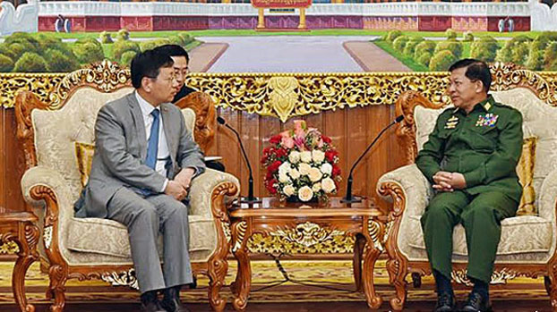 Myanmar Senior General Min Aung Hlaing (L), commander-in-chief of the country's armed forces, meets with Hong Liang (R), China's 