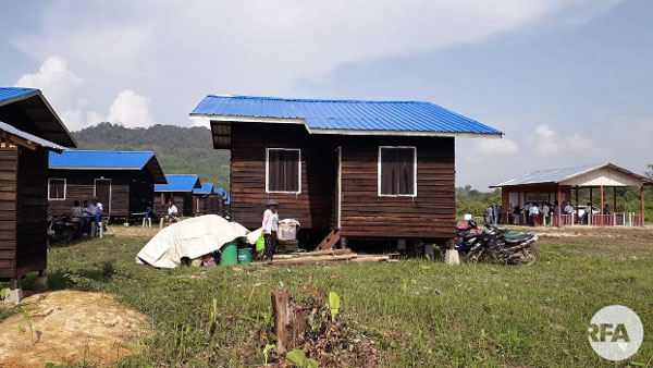 Civilians displaced by armed conflict move into new government-built homes in Waingmaw township, northern Myanmar's Kachin state, June 19, 2018.
