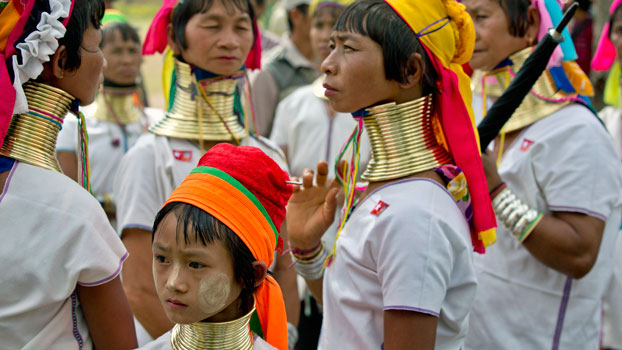 Ethnic Kayan women gather for a National League for Democracy party campaign rally in Demoso township, eastern Myanmar's Kayah state, Sept. 10, 2015.