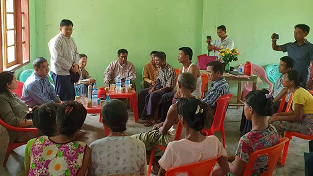 The Myanmar National Human Rights Commission conducts interviews with residents of Kyauktan village in Rakhine state's Rathedaung township about a deadly army shooting that took place there, May 31, 2019.