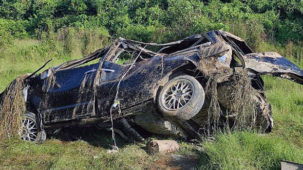 The wreckage of a car blown up by a landmine sits on the side of a road in Maungdaw township, western Myanmar's Rakhine state, Nov. 17, 2020.