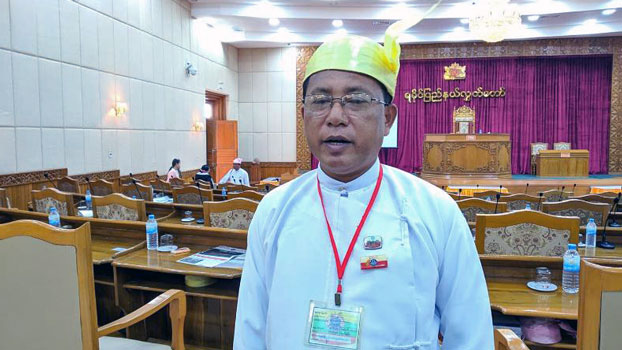 Poe San, an Arakan National Party lawmaker who represents Kyaukphyu township in the Rakhine state parliament, stands in the parliament building in Sittwe, western Myanmar's Rakhine state, Feb. 13, 2019.