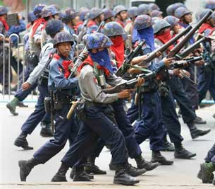 Armed security forces march down the streets of Rangoon during a crackdown on anti-government protests, Sept. 27, 2007.