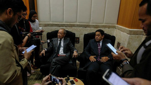 Royal Commission of Inquiry Chairman Arifin Zakaria (seated, left) and Deputy Chairman Norian Mai speak to reporters in Putrajaya, Malaysia, June 18, 2019.