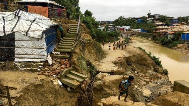 Rohingya children walk around an area hit by deadly monsoon-triggered landslides at Balukhali refugee camp in Ukhia, Bangladesh, July 7, 2019.