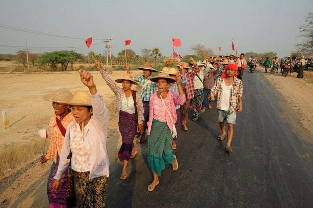 Protesters march near the Letpadaung copper mine in Salingyi township, Sagaing on March 13, 2013.