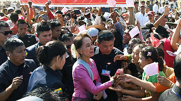 A crowd greets Myanmar State Counselor Aung San Suu Kyi upon her arrival in Munaung town, Kyaukpyu district, western Myanmar's Rakhine state, Dec. 19, 2019.