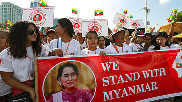 People attend a rally in Yangon to show support for Myanmar's leader Aung San Suu Kyi as she prepares to defend the country against genocide charges at the UN's top court, Dec. 1, 2019.