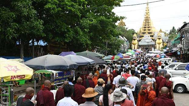 Supporters of ultra-nationalist monk Wirathu gather to pray at Shwedagon pagoda in Yangon, May 30, 2019.