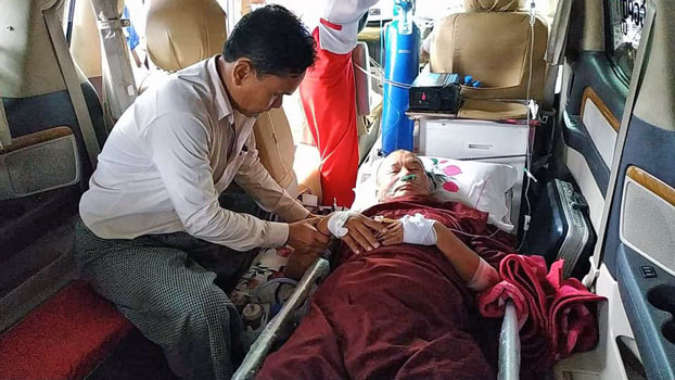 A Buddhist abbot injured by a mortar shell explosion at a monastery near Meewa village, Kyauktaw township, in western Myanmar's Rakhine state, is transported to Sittwe General Hospital, Oct. 1, 2019.