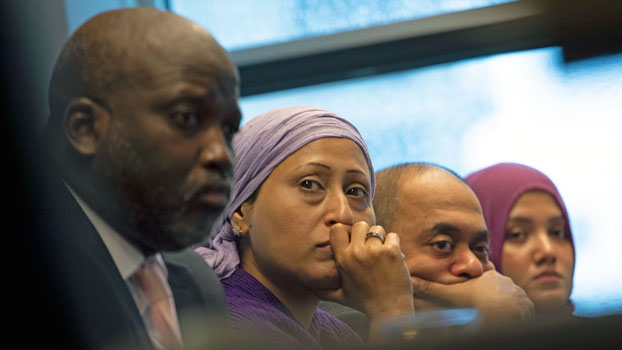 Representatives from the Rohingya community and Gambia's Justice Minister Aboubacarr Marie Tambadou (L) listen to testimony during a press conference in The Hague, the Netherlands, where the West African nation filed a case at the International Court of Justice accusing Myanmar of genocide against Rohingya Muslims, Nov. 11, 2019.