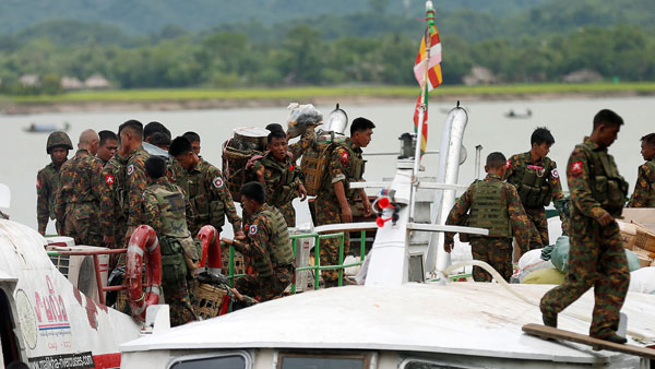 Myanmar soldiers arrive by boat at a jetty in Buthidaung township following deadly attacks by the Arakan Rohingya Salvation Army in western Myanmar's Rakhine state, Aug. 29, 2017.