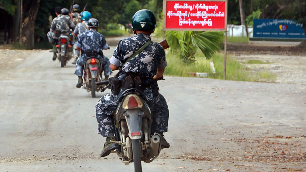 Armed Myanmar border police on motorcycles approach their headquarters in the Kyinkanpyin area of Maungdaw township, western Myanmar's Rakhine state, Oct. 17, 2016.