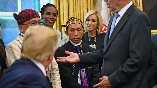 US President Donald Trump (L foreground) meets with Rev. Hkalam Samson (L background) and Langjaw Gam Seng (C) from Myanmar's Kachin Baptist Convention at the White House in Washington, July 17, 2017.