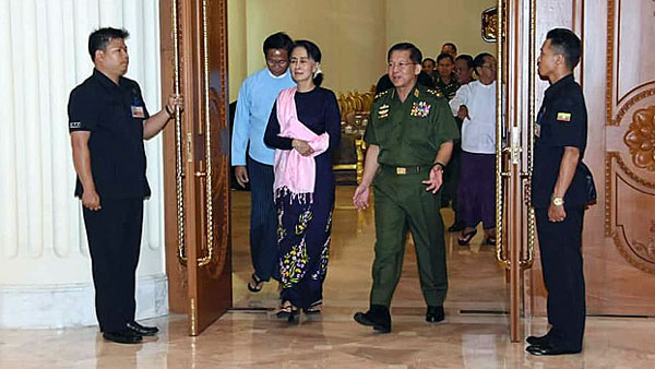 State Counselor Aung San Suu Kyi (3rd from L) and Senior Chief Min Aung Hlaing (3rd from R) emerge from a meeting on national security and international relations in Naypyidaw, June 8, 2018.