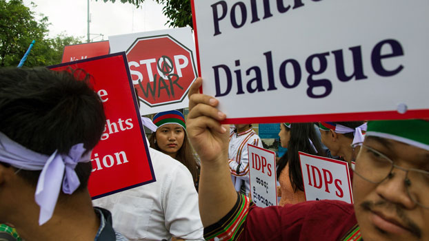 Ethnic Chin people hold placards during a protest in Yangon demanding an end to armed conflict in western Myanmar's Rakhine and Chin states, July 13, 2019.