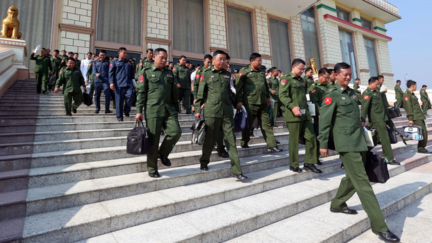 Myanmar military lawmakers leave parliament after a vote to set up a committee to amend the country's 2008 constitution, in Naypyidaw, Jan. 29, 2019.